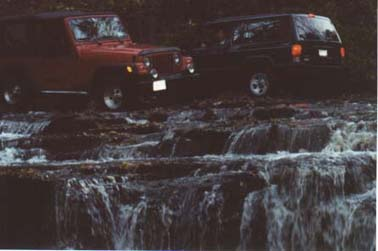 Jeeps on Waterfall